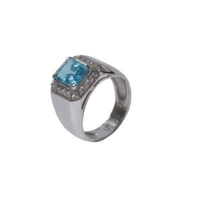 Γυναικείο δαχτυλίδι σε λευκό χρυσό Κ14 με λευκά ζιργκόν και blue topaz b9bc0a1f6a8